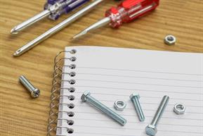 Spiral bound notebook with screwdrivers, screws and bolts