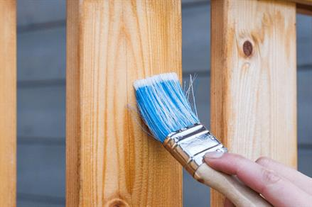 Staining wood with a paintbrush
