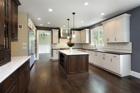 Dark wood kitchen with white cabinetry