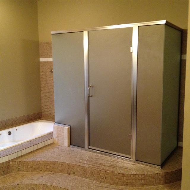 Remodeled bathtub and shower with step
