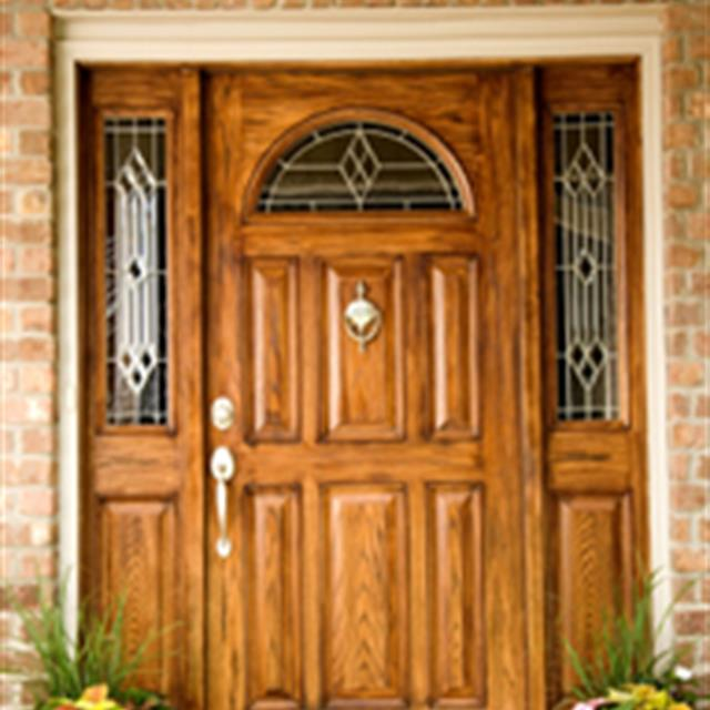 wooden front door with glass elements