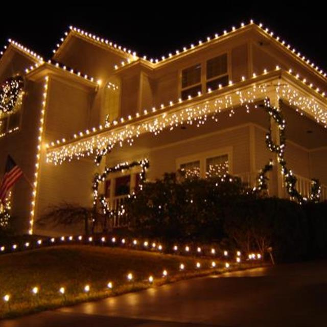 Christmas light hung on exterior of home