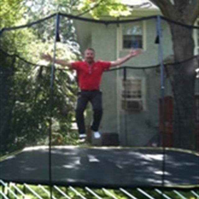 handyman jumping on a trampoline