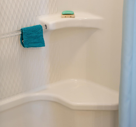 Washcloth and bar of soap inside a shower