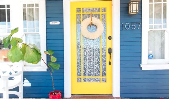 Blue Home With Yellow Door