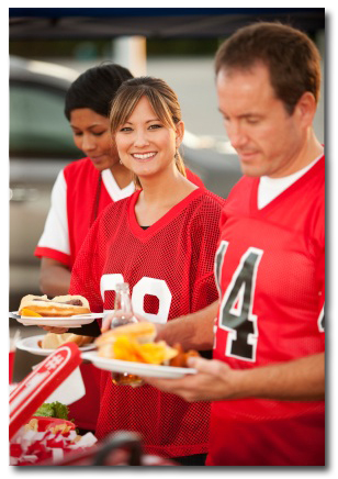 tailgating people holding food