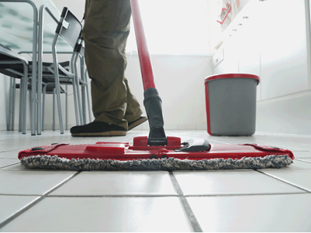 mopping white tile