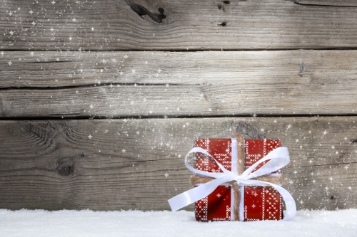 holiday gift on a wooden deck