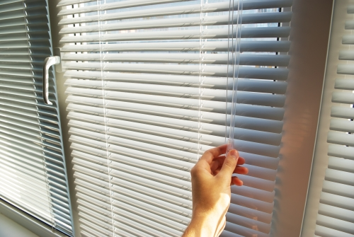 hand operating blinds