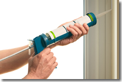 Applying Caulk to a Window Frame