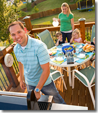 Family enjoying time on the deck after repairs are complete.