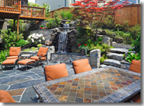 Patio with Table, Fountain, Rock Stair and Overhanging Deck