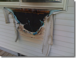 Vinyl Siding melted by propane grill.