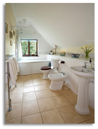 white bathroom with brown tile