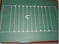Table with football field drawn onto it