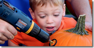 Kid watching a drilled pumpkin