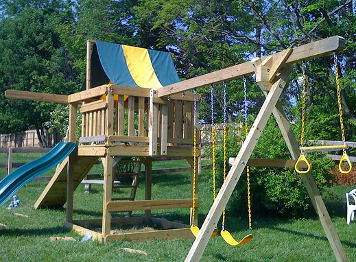 Installing swing sets and play structures mr handyman for Free playhouse plans with slide