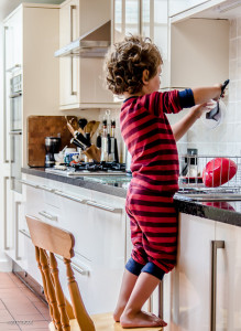 child helping in the kitchen