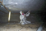 Handyman in crawlspace