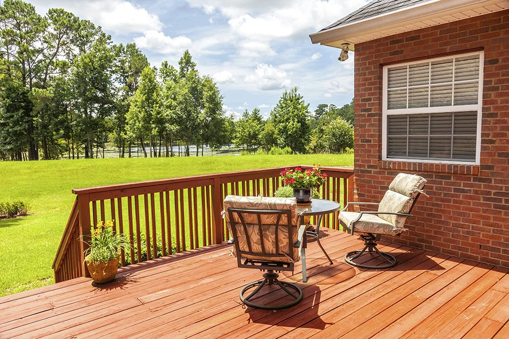 wooden deck overlooking green field