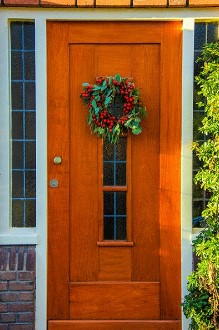 orange wood door with wreath