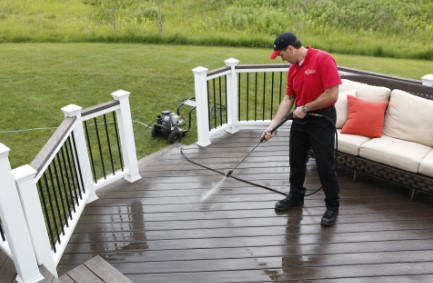 Mr Handyman pressure washing a deck