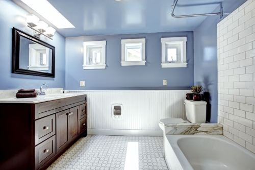 Blue bathroom with white tile-work