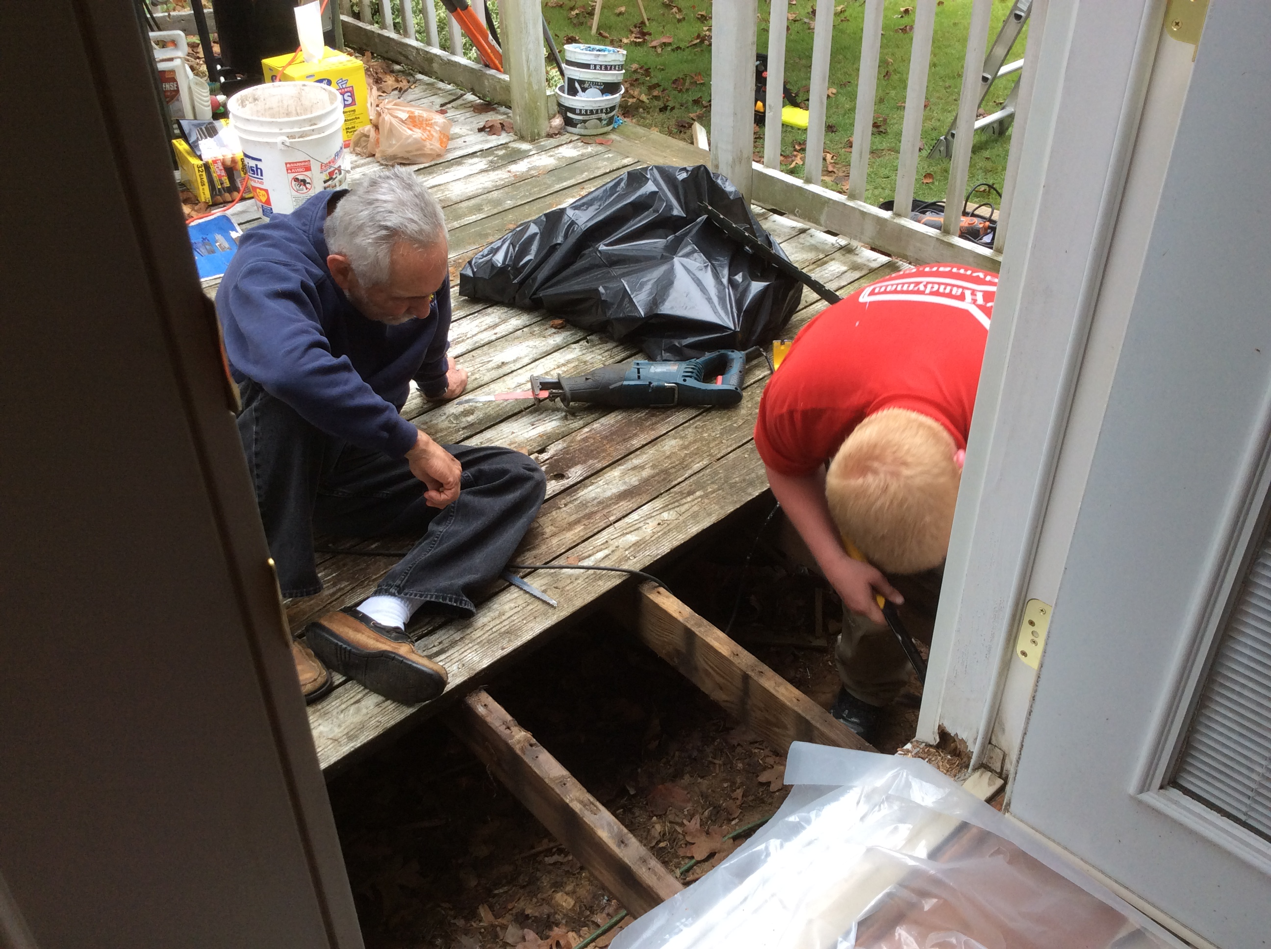 two men working on wood deck