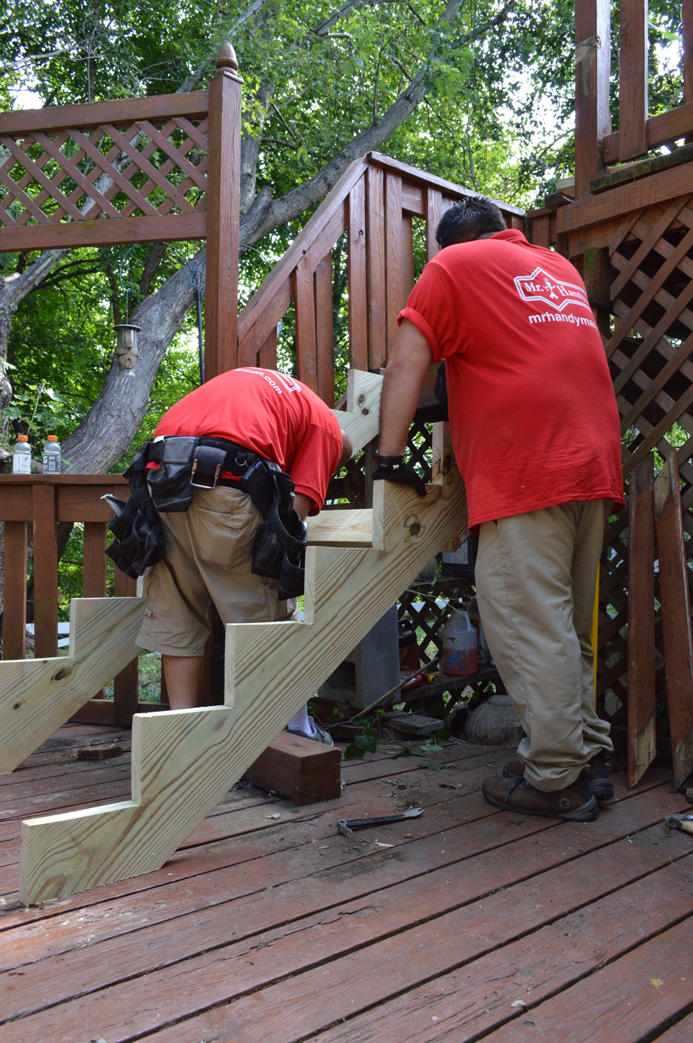 two men working on wooden staircase