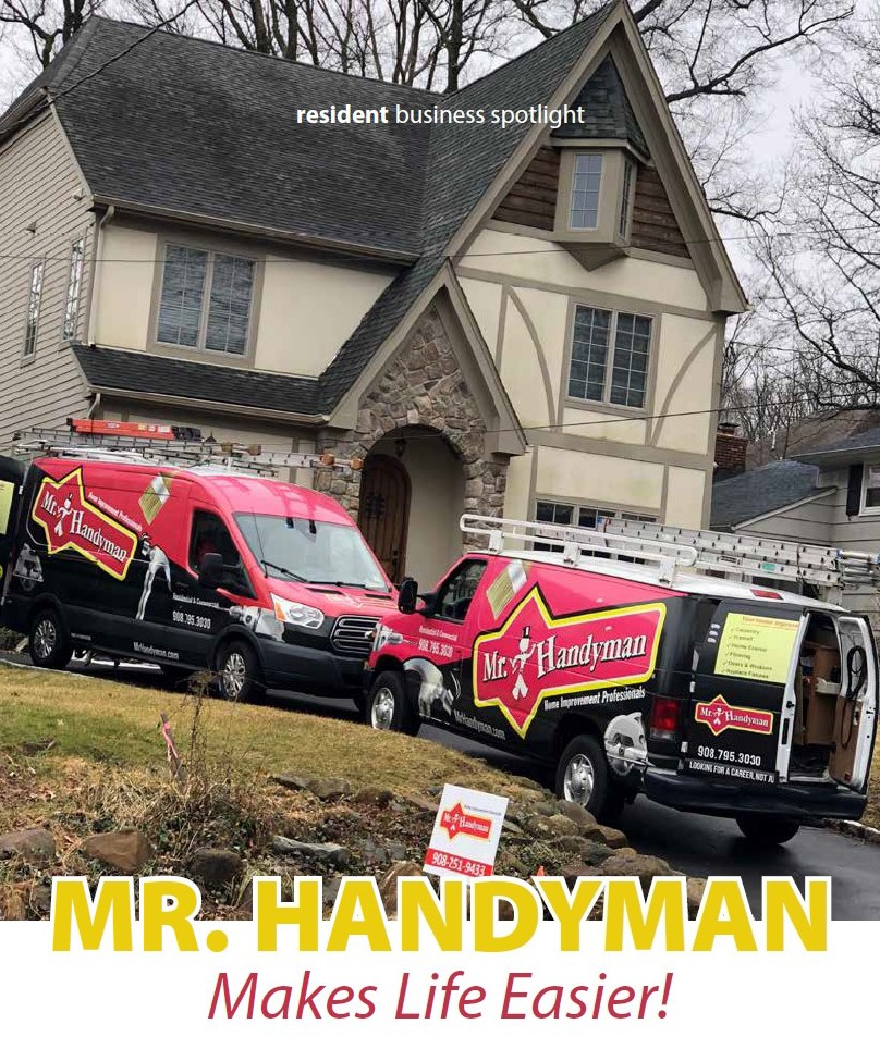 Two Mr. Handyman Vans in front of home